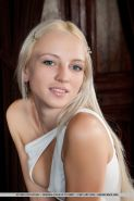 Sensual blonde teen Alysha removes her dress to show off her muff