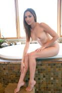 Sugary amateur babe Cassie Laine gets naked and takes warm bath