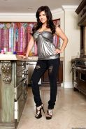 Busty Sunny Leone on high heels strips to her hot naked body