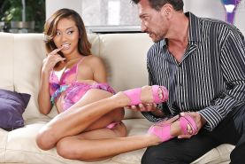 Asian Alina Li has her sexy toes and shaved pussy sucked on