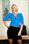 MILF babe with big tits Mellanie Monroe strips naked in the office