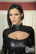 Sexy MILF in latex dress Dylan Ryder stripping and touching herself