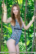 Teen glamour babe Izabel A freeing tiny tits from bikini outdoors in forest