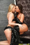 Latex and lingerie attired lesbians Aj Applegate and Abigail Mac lick twats