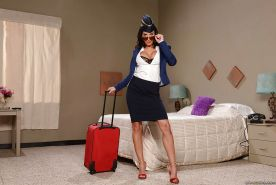 Busty babe Lezley Zen lets her big juggs escape from stewardess uniform
