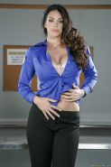 Brunette babe Alison Tyler freeing large natural tits in office