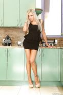 Blonde babe Nina Elle stripping down to her underwear in kitchen