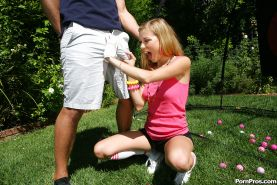 Young blonde girl Nicole Ray giving large dick oral sex outdoors on lawn