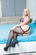 Blond wife AJ Applegate showing off sexy ass in black fishnet stockings on bed