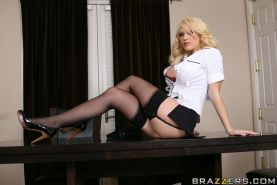 Gorgeous blonde Kagney Linn Karter shows her pussy on the office desk
