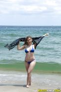 Beach babe Lena Paul freeing nice melons from bikini by swimming pool
