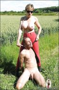 Topless mature femdom in red tights torturing her male pet's cock outdoor