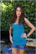 Adorable babe on high heels Kortney Kane stripping and spreading her legs