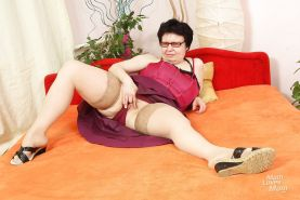 Chubby granny in glasses taking off her panties and toying her muff