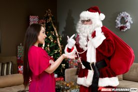 Latina slut Lola Foxx down on knees to give Santa Claus oral sex under tree