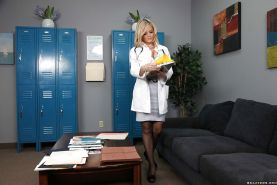 Blonde Alexis Texas with big tits has sex in a doctor's uniform