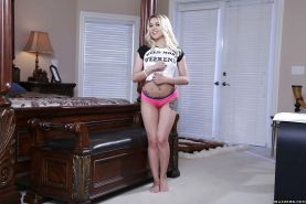 Young pornstar Marsha May slipping pink panties over tight ass