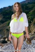 Teen babe Izabel A sporting nice camel toe outdoors on beach in bikini