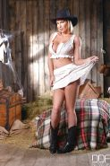 Blonde MILF Leigh Darby posing non nude in cowgirl boots and hat