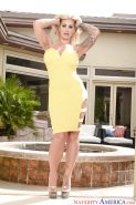 Tattooed blonde babe Ryan Conner unveiling large MILF boobs outdoors
