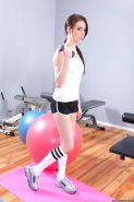 Shapely sports babe Jazy Berlin strips to knee high socks in the gym