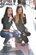 Lesbian teen girls injeans kissing, pissing and toying with dildo in public