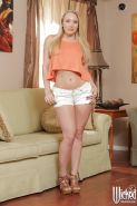Undressing blonde beauty AJ Applegate is revealing her tiny tits