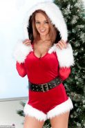 Amateur Nikki Sims in Christmas costume & boots undressing to air perfect tits