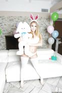 Blonde Playboy Bunny AJ Applegate posing in white stockings and high heels