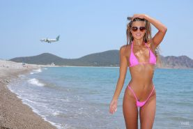 Flat chested blonde Maria stripping bikini to display tiny tits at the beach