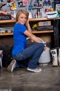 Non nude amateur model Madden in jeans flashing lace panties in the workshop