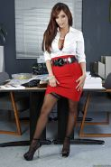Sexy secretary Reena Sky flashing long legs and stockings under skirt