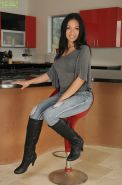 Hot Latina MILF Eva Estrella modelling solo in knee high boots and jeans