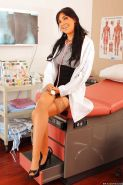 Hot doctor babe Diana Prince strips off uniform and poses in stockings