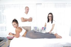 Pornstars Kelsi Monroe and Lily Jordan receive massage before three way sex