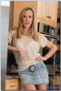 Stunning MILF on high heels Brandi Love stripping down in the kitchen