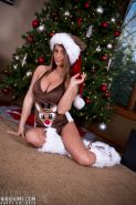 Amateur brunette slut Nikki Sims in Christmas costume on knees flaunting tits