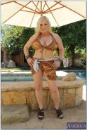 Fatty blonde MILF with big jugs Rachel Love taking off her bikini outdoor