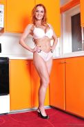 Big busted MILF on high heels Janet Mason stripping off her lingerie