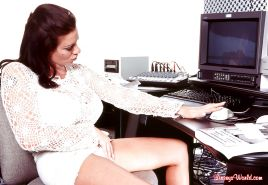 European MILF Linsey Dawn McKenzie stripping naked in her home office