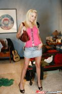 Big tits blondie Riley Steele is revealing her long legs in high heels