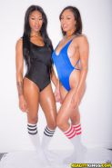 Ebony dykes Cherry Hilson and Nadia Jay pose in knee high socks