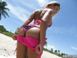 Teen babe Marsha May removes bikini on beach to bare phat ass and big boobs