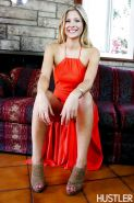Blonde pornstar Scarlet Red posing in long red dress and high heels