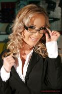 Blonde MILF in glasses Jessica Moore uncovering her voluptuous body