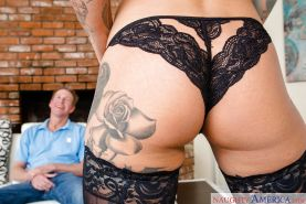 Busty tattooed blonde Kleio Valentien giving big cock a bj in stockings