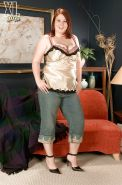 Bigtitted fatty Risque Waters showing off in jeans and fondling big boobs