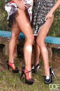 Leggy lesbians Lucy Li and Tracy Lindsay suck naked toes outdoors in woods