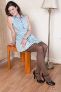 Older hairy woman Sunshine poses in nylons and patent leather shoes