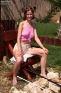 Amateur chick Angel Shines spreading her pink pussy outdoors